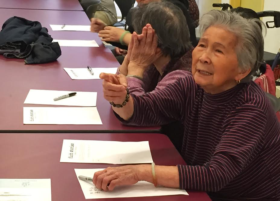 Xue Fang Chan at the Workshop with Seniors at the Two Bridges Senior Apartments run by Hamilton