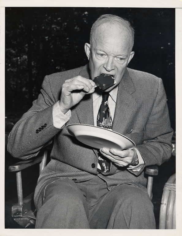 NMAH Archives Center Good Humor Ice Cream Collection 0451 Box 1 Folder 7 Photograph of President Dwight D. Eisenhower eating a Good Humor Bar, taken by International News Photos of New York.